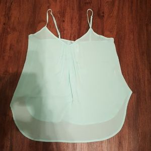 Light and flowing mint green tank